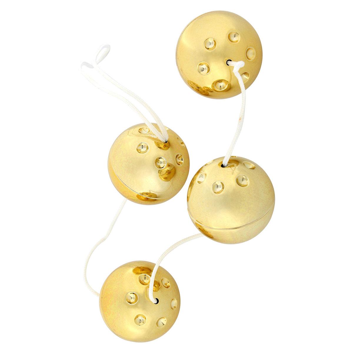 Четыре золотистых вагинальных шарика - фото 312711