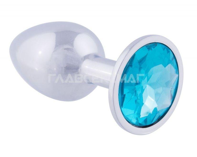 Серебристая анальная пробка с голубым кристаллом - 9,5 см.