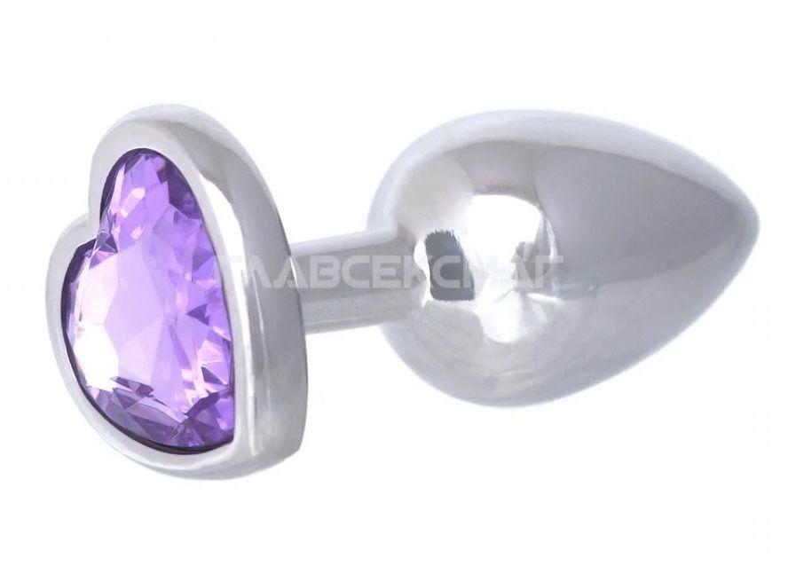 Серебристая анальная пробка с сиреневым кристаллом-сердцем - 7 см.