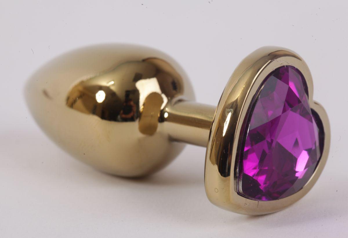 Золотистая анальная пробка с фиолетовым стразиком-сердечком - 7,5 см. - фото 194590