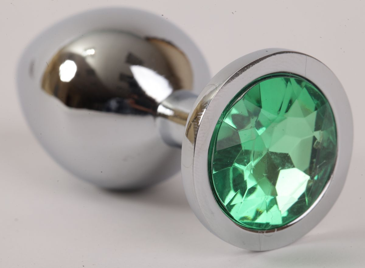 Серебристая анальная пробка с зеленым стразом - 8,2 см.