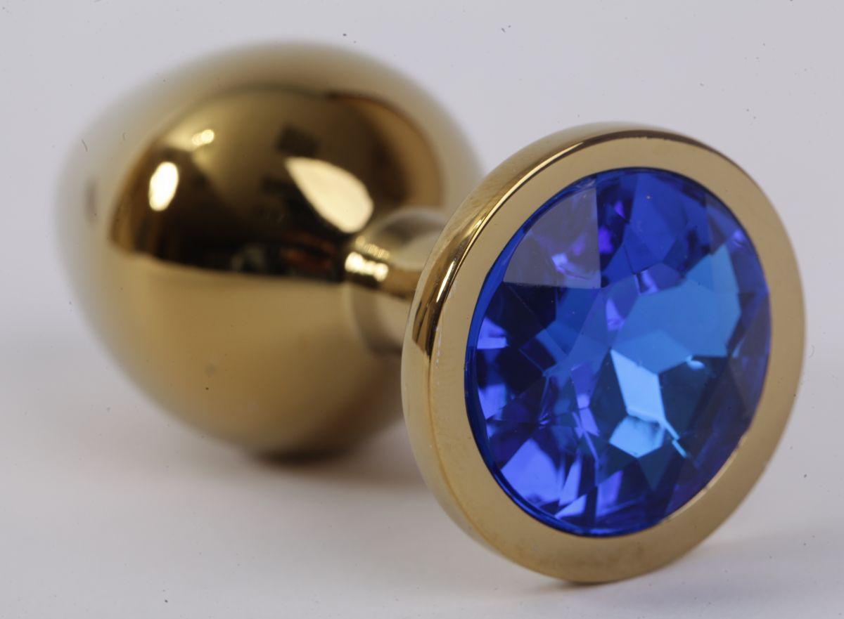 Золотистая анальная пробка с синим кристаллом - 9,5 см. - фото 194646