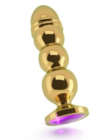 Золотистая фигурная анальная пробка R10 RICH Gold/Purple с фиолетовым кристаллом - 14,5 см.