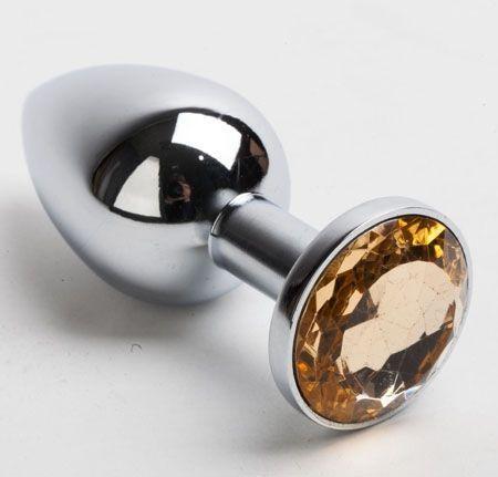 Серебристая анальная пробка с желтым кристаллом - 8,2 см. - фото 199367