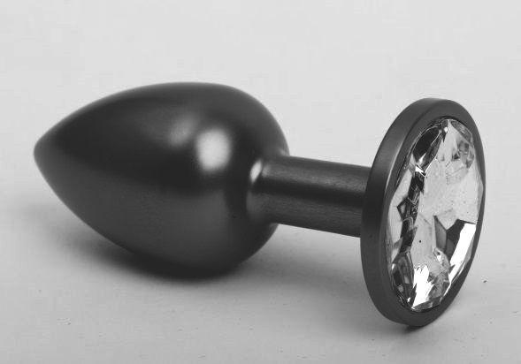Чёрная анальная пробка с прозрачным стразом - 7,6 см.