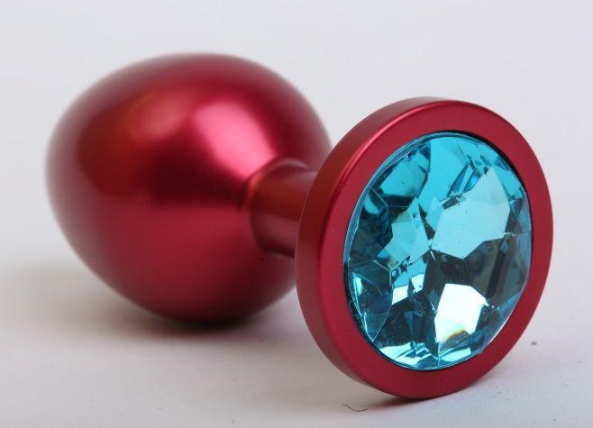 Красная анальная пробка с голубым стразом - 8,2 см.
