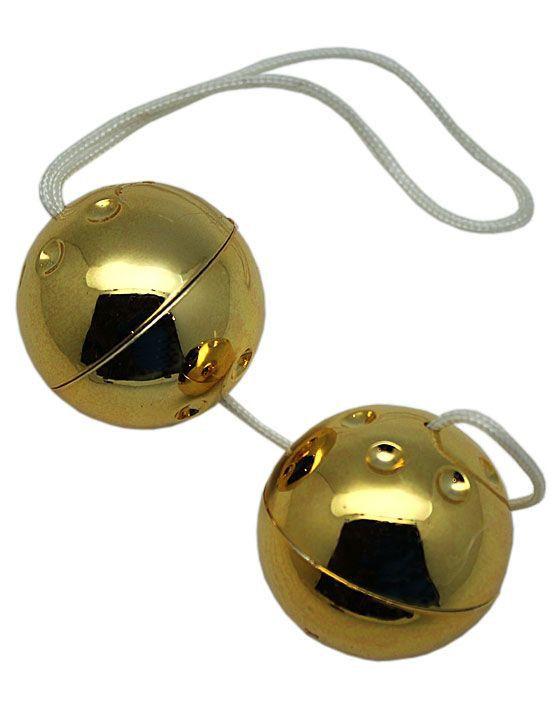 Золотистые шарики со смещённым центром тяжести