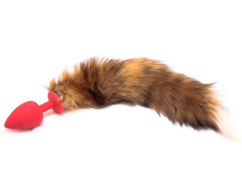 Красная силиконовая анальная пробка с рыжим хвостом размера M - 8 см.