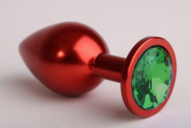 Красная анальная пробка с зелёным стразом - 7,6 см.