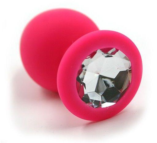 Розовая силиконовая анальная пробка с прозрачным кристаллом - 7 см.