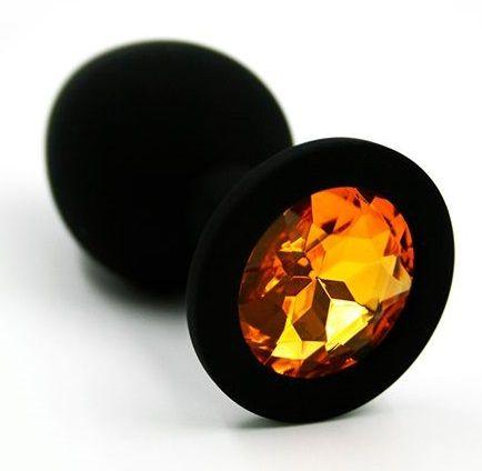 Чёрная силиконовая анальная пробка с жёлтым кристаллом - 7 см.