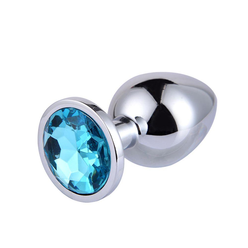 Серебристая анальная пробка с голубым кристаллом - 8,2 см.