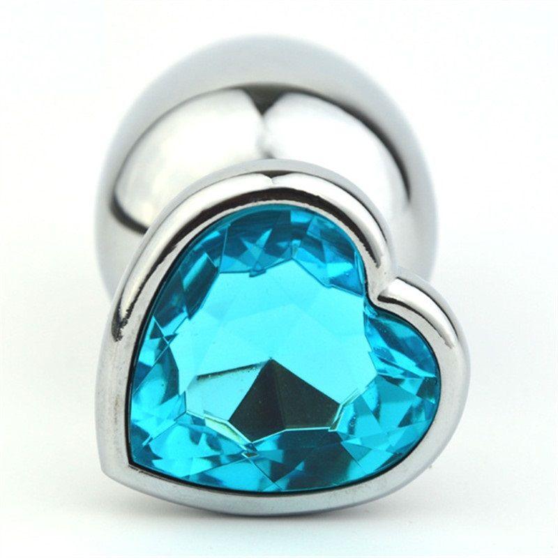 Серебристая анальная пробка с голубым кристаллом-сердечком - 8 см.