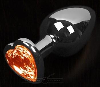 Графитовая анальная пробка с оранжевым кристаллом в виде сердечка - 6 см.