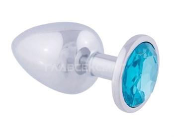 Серебристая анальная втулка с голубым кристаллом - 8,2 см.