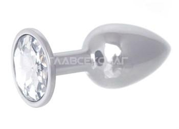 Серебристая анальная втулка с прозрачным кристаллом в основании - 7 см.