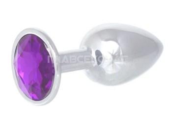 Серебристая анальная пробка с фиолетовым кристаллом - 7 см.