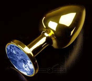 Золотистая анальная втулка с синим стразом - 7 см.