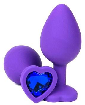 Фиолетовая силиконовая анальная пробка с синим стразом-сердцем - 10,5 см.