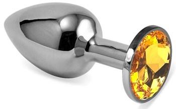 Серебристая гладкая анальная пробка с оранжевым кристаллом - 9 см.