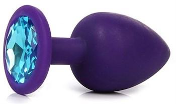 Фиолетовая анальная пробка с голубым кристаллом - 9,5 см.