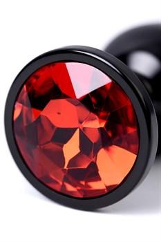 Черный анальный плаг с кристаллом красного цвета - 7,2 см.