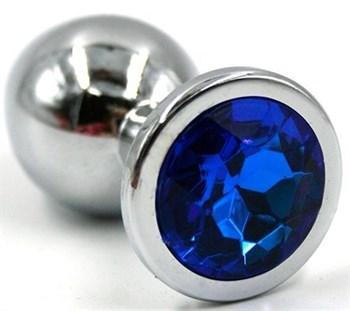 Серебристая коническая анальная пробка с синим кристаллом - 7 см.