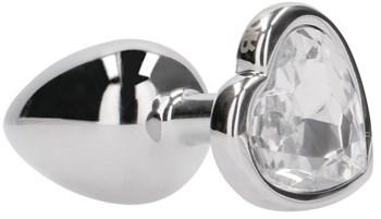 Серебристая анальная пробка с прозрачным кристаллом в форме сердца - 7,1 см.