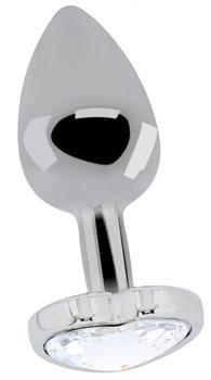 Серебристая анальная пробка с прозрачным кристаллом в форме сердца - 8,2 см.