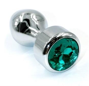 Серебристая анальная пробка с объемным изумрудным кристаллом - 10 см.