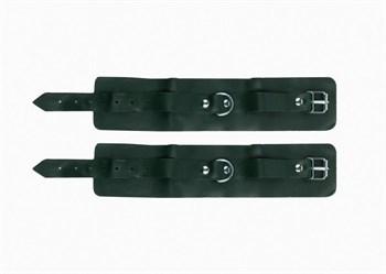 Изумрудные кожаные наручники