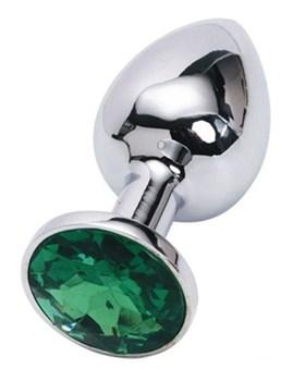 Серебристая анальная пробка с изумрудным кристаллом - 7 см.