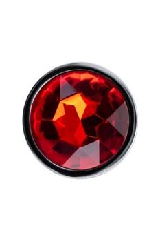 Серебристая коническая анальная пробка с красным кристаллом - 7 см.