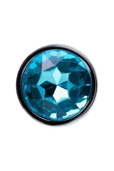 Серебристая анальная втулка с голубым стразом - 7 см.