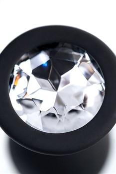 Черная анальная втулка с прозрачным стразом - 7,2 см.