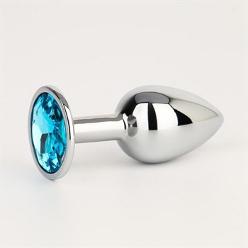 Серебристая анальная втулочка с голубым кристаллом - 7 см.