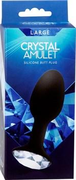 Чёрная силиконовая анальная пробка с кристаллом в основании - 8,5 см.