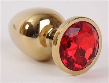 Золотистая анальная пробка с красным кристаллом - 9,5 см.