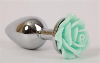 Серебристая анальная пробка с зеленой розочкой - 7,6 см.