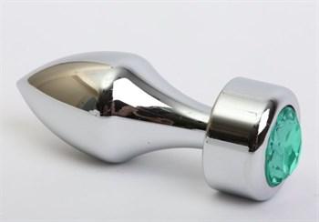 Серебристая анальная пробка с широким основанием и зелёным кристаллом - 7,8 см.