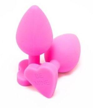 Розовая силиконовая пробка с енотовым хвостом