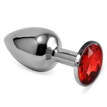 Серебристая анальная пробка с красным кристаллом размера S - 7 см.