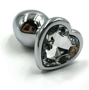 Серебристая анальная пробка с прозрачным сердцем-кристаллом - 7 см.