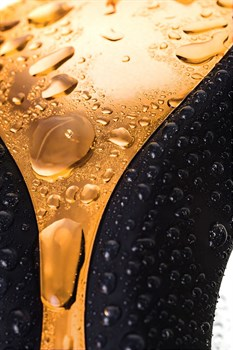 Чёрно-золотой клиторальный вибромассажер WANAME Surf
