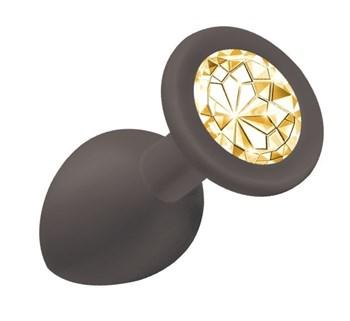 Чёрная анальная пробка Emotions Cutie Small с жёлтым кристаллом - 7,5 см.