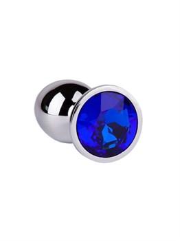 Серебристая анальная втулка с синим кристаллом - 7 см.