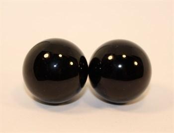 Чёрно-белые вагинальные шарики со смещенным центром тяжести