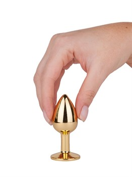 Золотистая анальная втулка с малиновым кристаллом - 7 см.