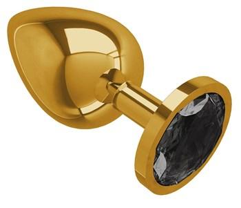 Золотистая большая анальная пробка с чёрным кристаллом - 9,5 см.