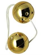 Золотистые шарики со смещённым центром тяжести - фото 1165927